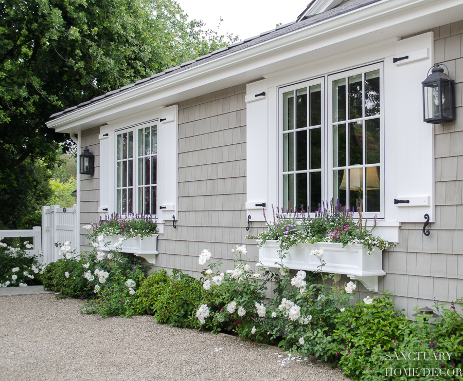 How window shutters and planter boxes transformed the - Pictures of exterior shutters on homes ...