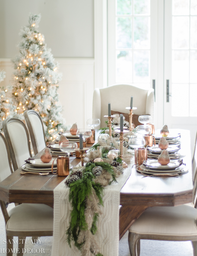 Christmas Table Setting with copper and greenery