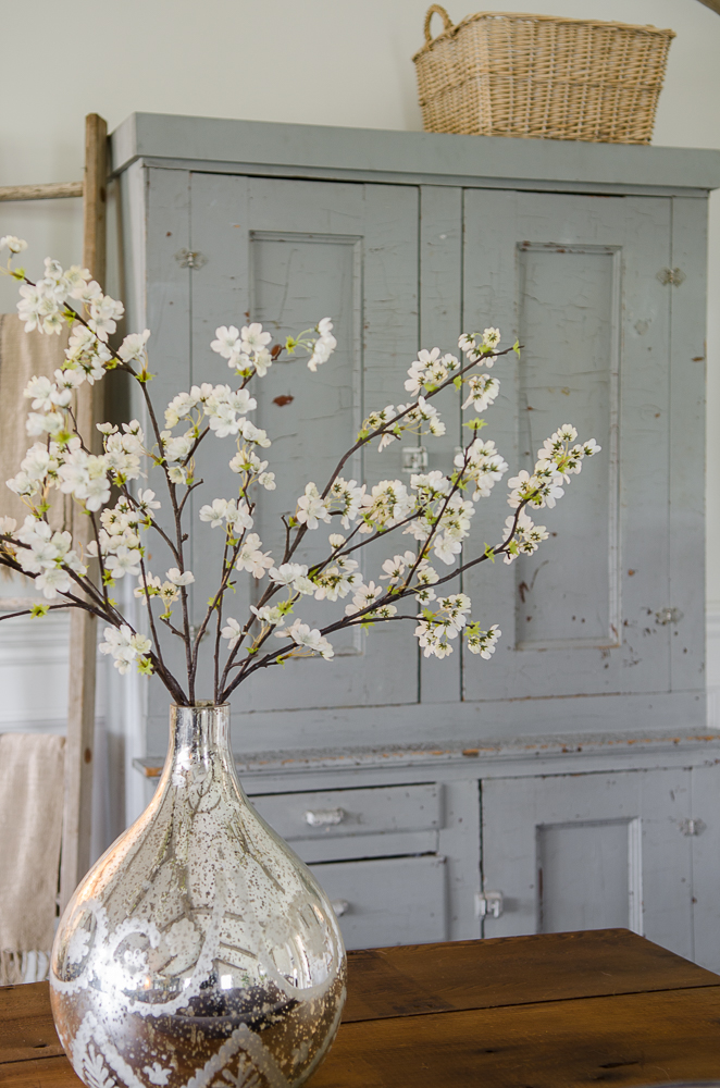 Light and Bright family room refresh in 5 easy steps-Chippy Cabinet-Mercury glass vase-Cherry Blossoms