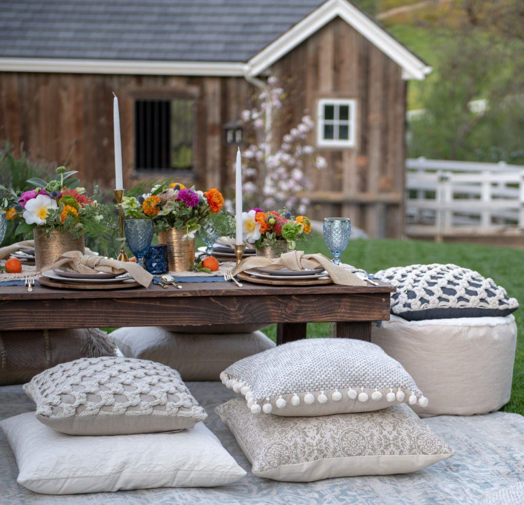 Bohemian table setting - macrame table runner - Poufs- Pillows- Moroccan Tablescape - Morocan Dinner Party- Moroccan Table Setting