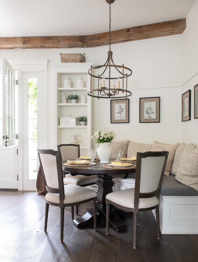 breakfast nook with banquette- round dining table