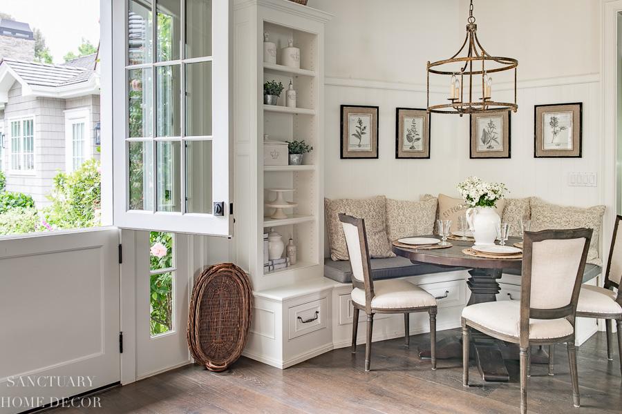 Breakfast nook with banquette and Dutch door
