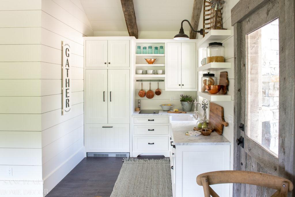 Small Farmhouse Kitchen design Ideas- Barn wood Door-Floating Shelves -Barn Light - Farmhouse Sink- Paneled Refrigerator