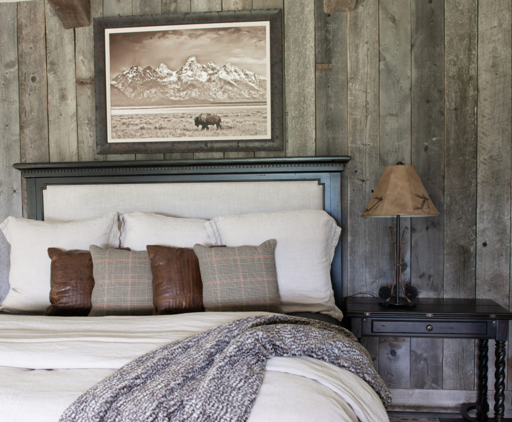 reclaimed barn wood wall with linen bed.