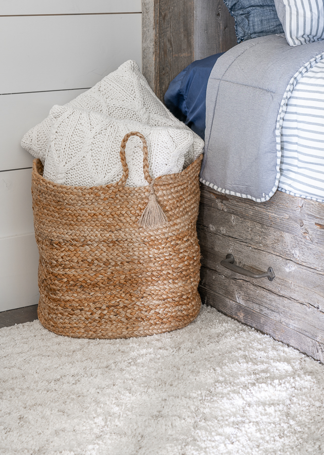 Jute basket in bunk room with knit pillows