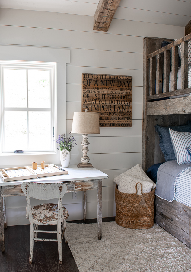 Kid's bunk room with shiplap walls and reclaimed wood bunk beds.