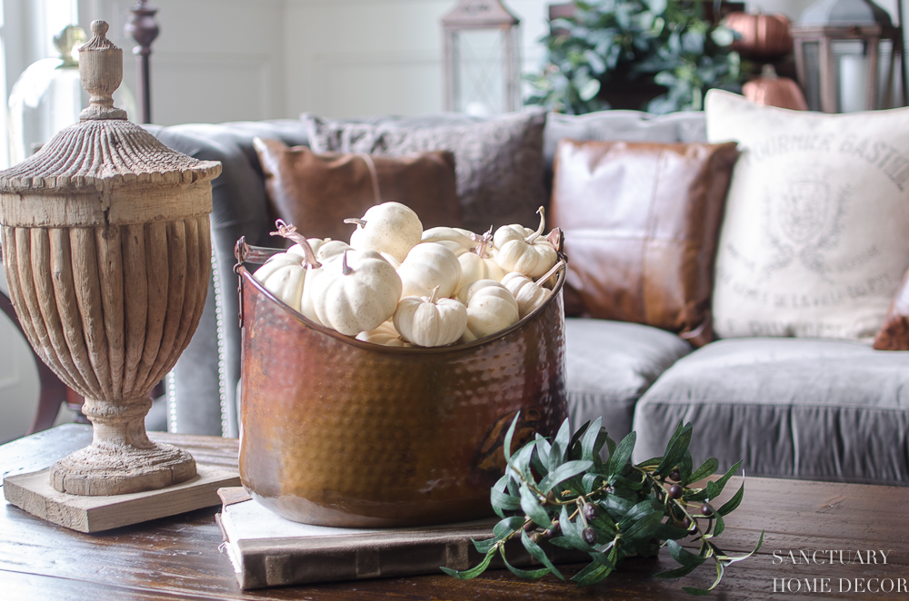 5 Minute Fall Decorating Tips-Copper bucket filled with mini white pumpkins.