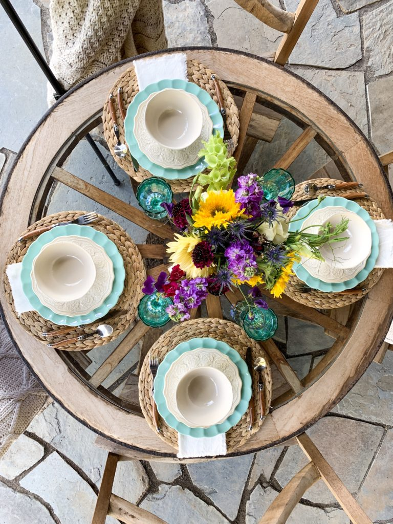 Colorful vintage chic table setting with turquoise and white plates