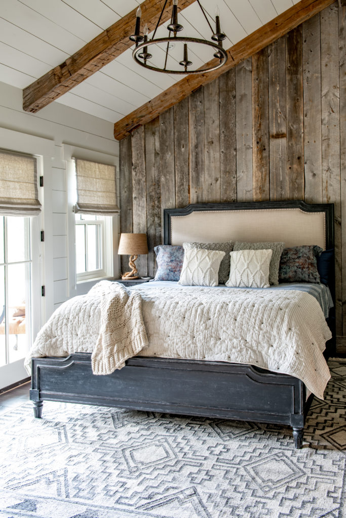 Bedroom with reclaimed wood accent wall.